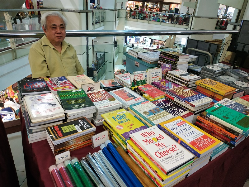 book seller at Amcorp mall flea market