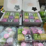 Buying ingredients, making and distributing mooncakes